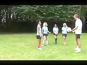 A handful of British Schoolgirls are very nice to their PE teacher