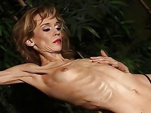 Exotic light-haired strips and shows her anorexic bod all alone