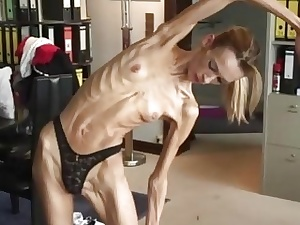Anorexic platinum-blonde girl Inna strips and flashes her flexible bod