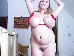 Chubby blonde with big boobs and huge coochie taking off her bikini