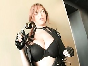 Horny chick dressed in leather clothing acting like a real whore on camera