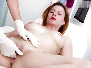 Wild crimson haired babe gets her cooter fuck hole tested on a gyno stool