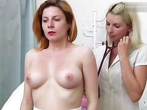 Red haired babe gets inspected by a mischievous platinum-blonde gynecology physician