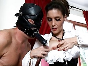 Nasty fellow is dressed in a black leather mask fucking her jaws